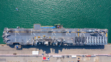 Aerial Top View USA Aircraft Carrier Warship Transportation Fighter Plane, Helicopter, Tank, Battleship.