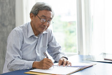 Asian Smart Business Elder Wri...