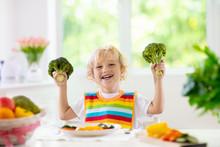 Baby Eating Vegetables. Solid Food For Infant.