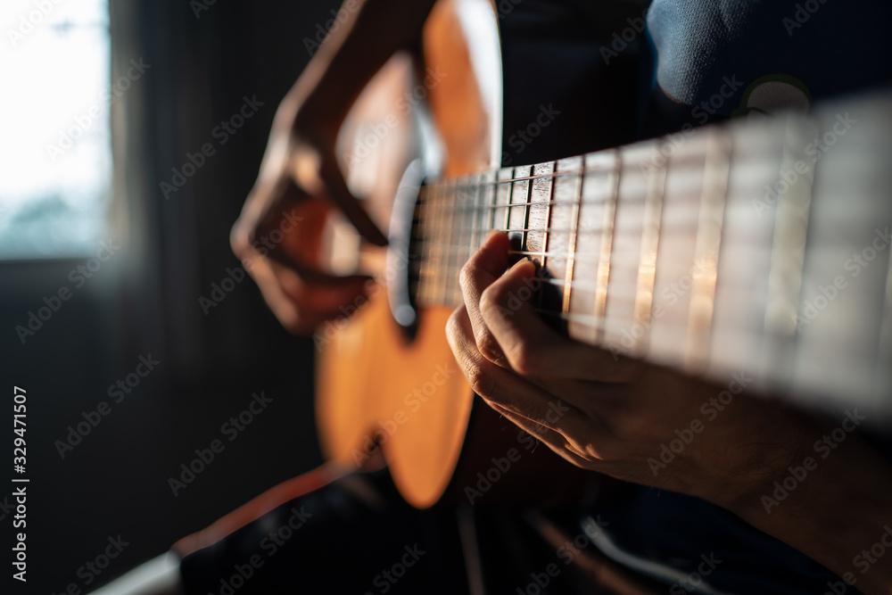 Fototapeta Playing Classical Guitar at Home
