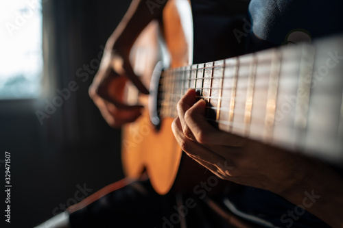 Obraz Playing Classical Guitar at Home - fototapety do salonu