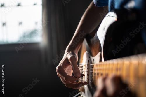 Obraz na plátně Playing guitar at home