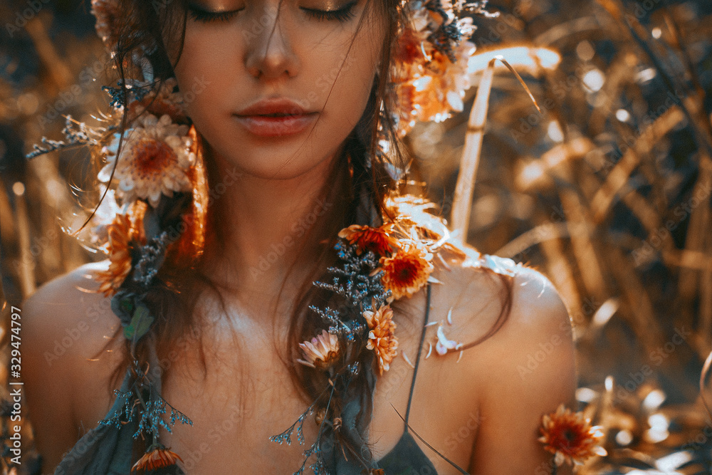Fototapeta close up portrait of young and tender woman on a feild at sunset