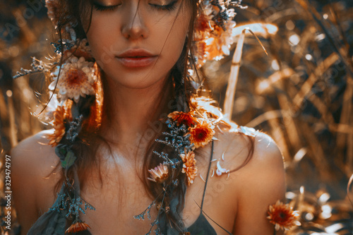 Fototapeta close up portrait of young and tender woman on a feild at sunset obraz