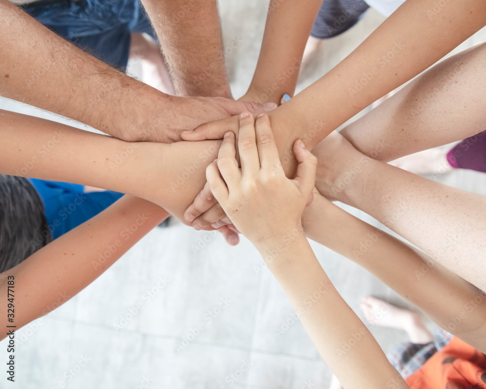 Fototapeta Group of people joining hands, success in teamwork, friends with hands together