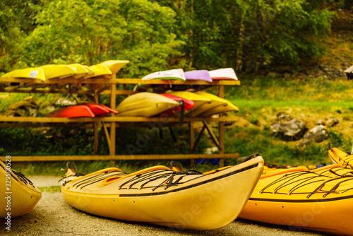 Obraz Kayaks on water shore. Rental area - fototapety do salonu