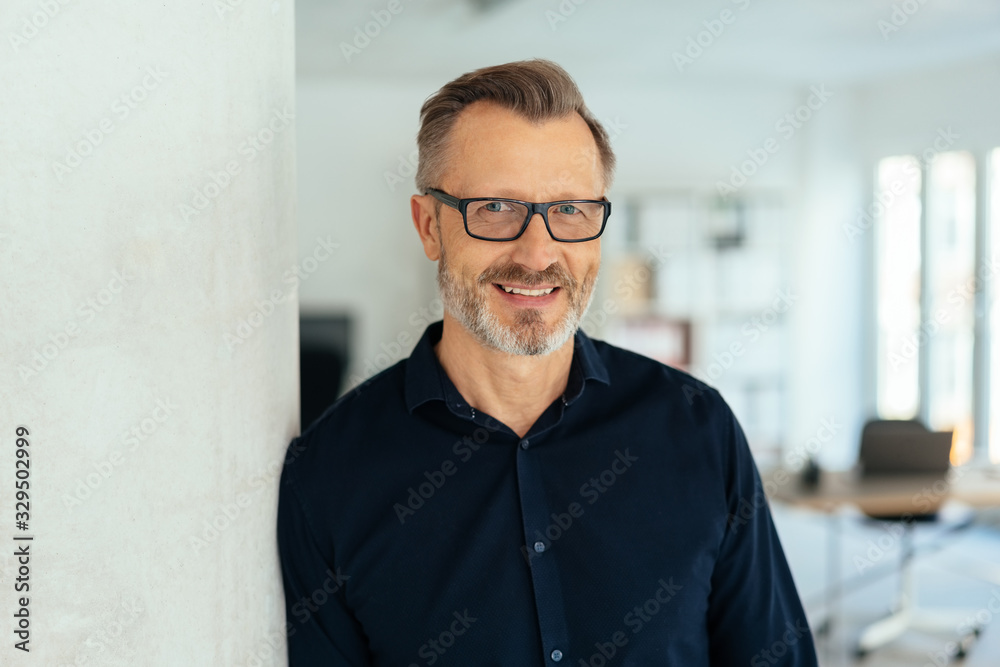 Fototapeta Smiling handsome middle-aged man in black shirt