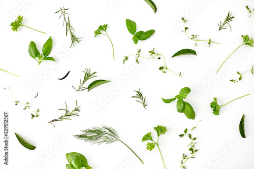 Fototapeta culinary, seasoning and organic concept - different greens, spices or herbs on w