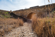 Old Stone Bridge Over The Dried River