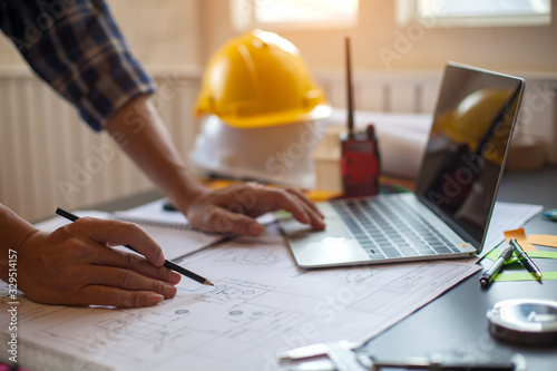 Obraz Concept Architect and desk of Architectural project in construction site or office building with mining light - fototapety do salonu