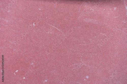 Red abrasive sandpaper seamless grunge surface macro view. Wallpaper Mural
