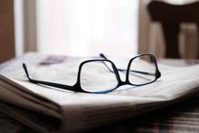 Glasses On A Newspaper