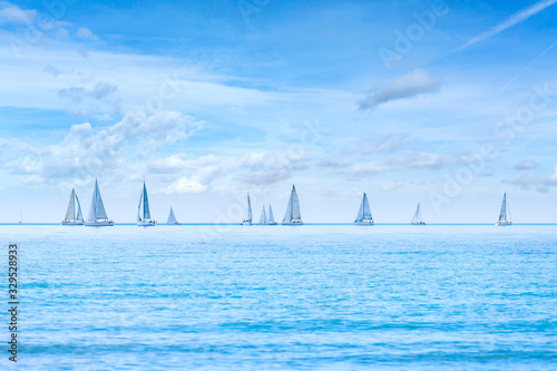 Foto Sailing boat yacht regatta race on sea or ocean water
