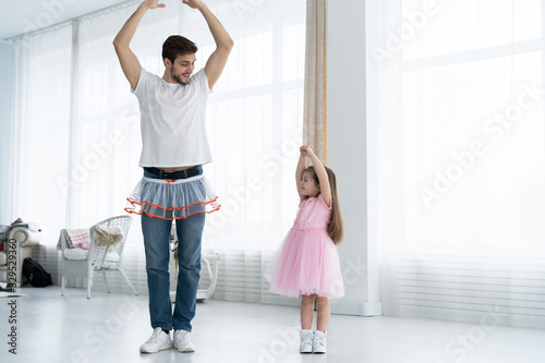 I love you, dad! Handsome young man is dancing at home with his little girl Tablou Canvas