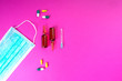 canvas print picture - Protective face mask on pink background, pills, needle