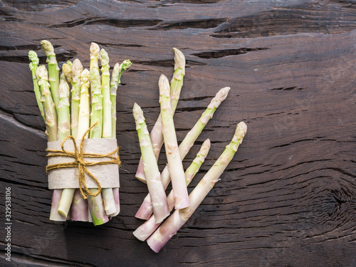White fresh asparagus sprouts on wooden table Canvas Print