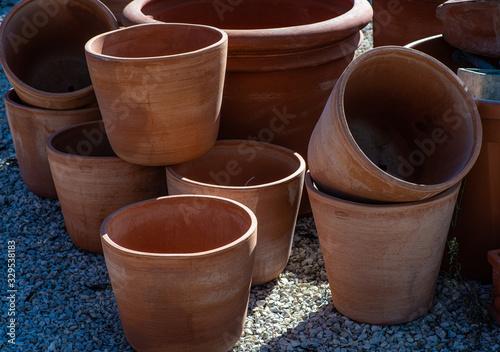 Fototapeta clay or terracota flowerpots for the garden obraz