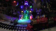 Beneath Christmas Tree Lights Baubles Globes Decorations Train