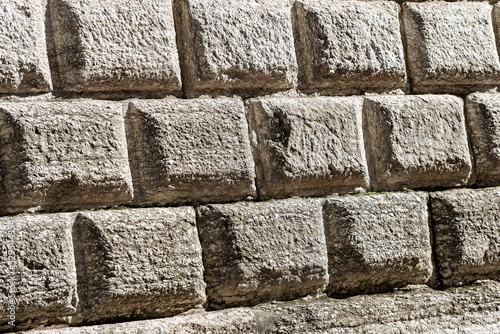 Ashlar (Bugnato in Italian), closeup of a wall made of big blocks of stones in T Canvas Print