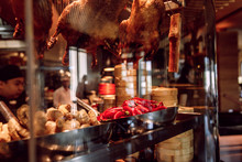 Showcase Of A Chinese Street Restaurant With Traditional Chinese Food And Products, Cook Behind Glass
