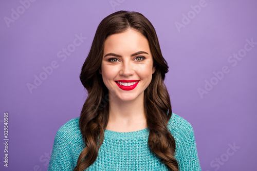 Obraz Closeup photo of beautiful amazing pretty lady red lips curly hairdo beaming smiling good mood wear blue knitted pullover isolated purple color background - fototapety do salonu
