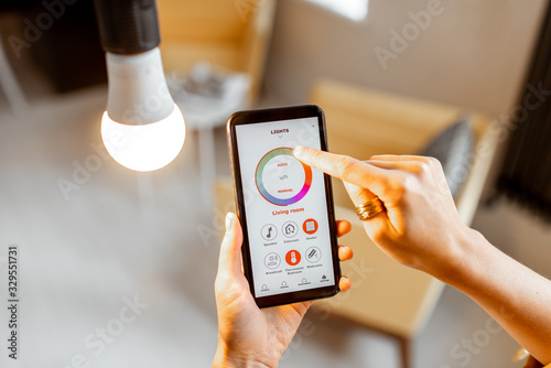 Obraz na płótnie Controlling light bulb temperature and intensity with a smartphone application