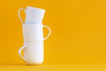 Three White Coffee Cups Stacke...