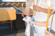 bride and groom holding hands under towel knot