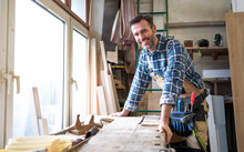 Portrait Of Middle Aged Carpenter In The Carpentry Workshop