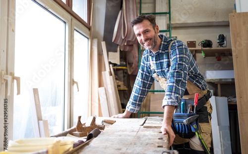Portrait of middle aged carpenter in the carpentry workshop Fototapet