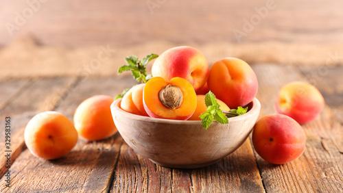Fotografija fresh apricot and leaf- summer fruit