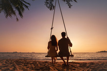 Honeymoon Travel, Silhouette Of Romantic Couple On Sunset  Beach, Tropical Holidays Near The Sea, Man And Woman Together On Vacation