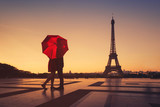 Fototapeta Fototapety Paryż - couple travel to Paris, silhouette of lovers kissing near Eiffel tower, romantic escape destination for valentines day