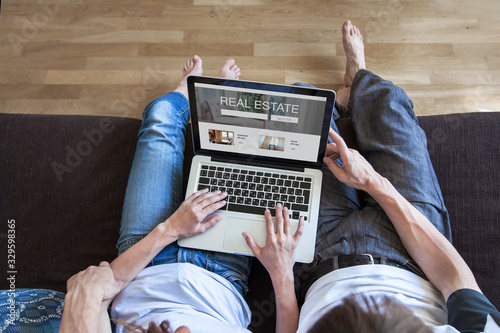 Fototapeta real estate concept on screen of computer, couple looking for apartment to rent or buy obraz