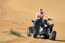 Muscular Man Topless Riding At...