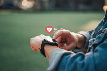 Close Up White Smart Watch With Icon Heart Rate, Healthcare Concept. Light And Shadow.