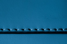 Texture Of Blue Genuine Leather Sewn With Stitch. For Fashionable Modern Background, Copy Space