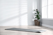 Unrolled Grey Yoga Mat On Floo...