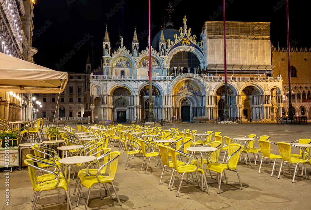 Fototapeta Night view of one Bar on the Piazza San Marco showing a multitude of empty chairs and empty square