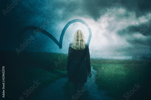 Concept sad woman on countryside road Canvas Print