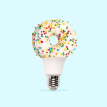 Lightbulb. White Suggared Donut Like Lamp On Light Blue Background. Copyspace For Your Ad. Modern Design. Contemporary Artwork, Collage. Concept Of Summertime, Vacation, Resort, Mood, Beach Season.