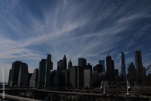 New York City Skyline with Clouds from Brooklyn Bridge Darkened