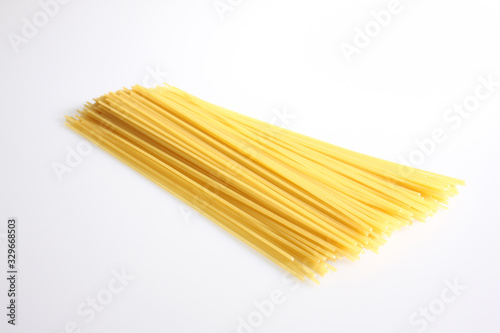 Obraz A studio photograph of loose uncooked spaghetti - fototapety do salonu