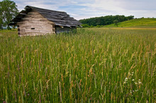 An Old Cabin From Another Time Still Stands On The Midwest Prairie.