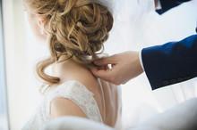 Hands Of Groom On Bridal Dress...