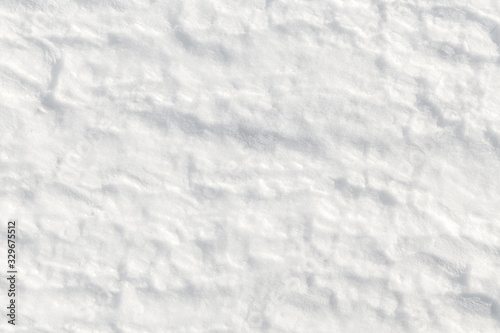 Fotografering Fresh snow background - packed, wind blown, pattern close-up