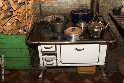 Obraz na plátně White wood stove with many holes on top, perfect for heating the house and makin