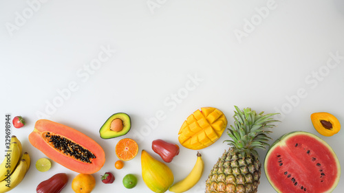 Photo Top view of assortment of exotic fruits and copy space on white background