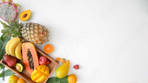 Top view of assortment of exotic fruits in a crate and copy space on white backg Canvas Print