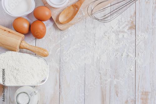 Obraz na plátně Homemade Dough Recipe (Eggs, flour, milk, sugar) and wooden kneading dough on a